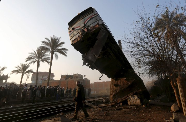 a-crowd-looks-at-the-wreckage-of-a-train-crash-in-beni-suef-south-of-cairo-egypt-on-february-11-2016