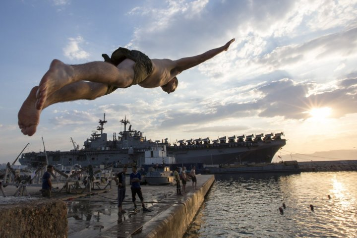 a-marine-from-the-uss-kearsarge-dives-into-the-waters-of-aqaba-jordan