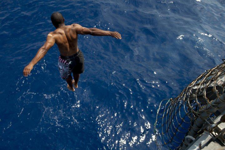 a-sailor-jumps-from-the-uss-jason-dunham-into-the-mediterranean-sea