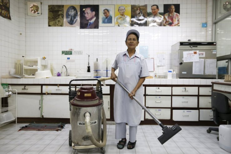darunee-kamwong-a-72-year-old-cleaner-poses-for-a-portrait-while-working-in-a-rice-vermicelli-factory-outside-bangkok-on-thailand-february-5-2016