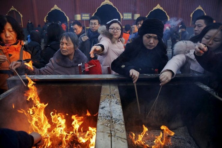 people-burn-incense-and-pray-for-good-fortune-on-the-first-day-of-the-lunar-new-year-of-the-monkey-at-yonghegong-lama-temple-in-beijing-china-on-february-8-2016