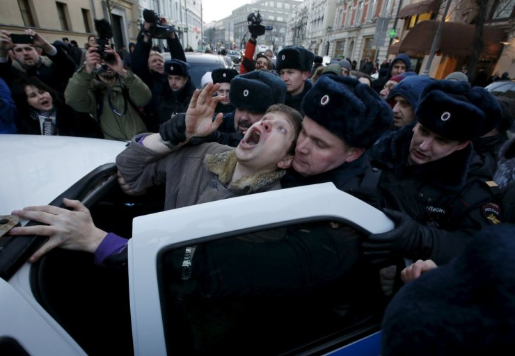 police-officers-detain-an-activist-who-was-taking-part-in-a-rally-of-foreign-currency-mortgage-holders-near-the-central-bank-headquarters-in-downtown-moscow-russia-on-february-8-2016