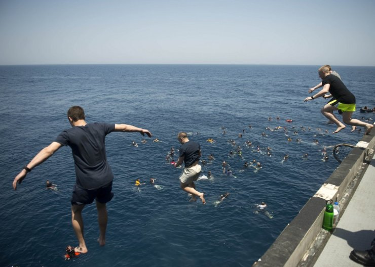 sailors-jump-from-the-aircraft-carrier-uss-dwight-d-eisenhower-in-the-north-arabian-sea