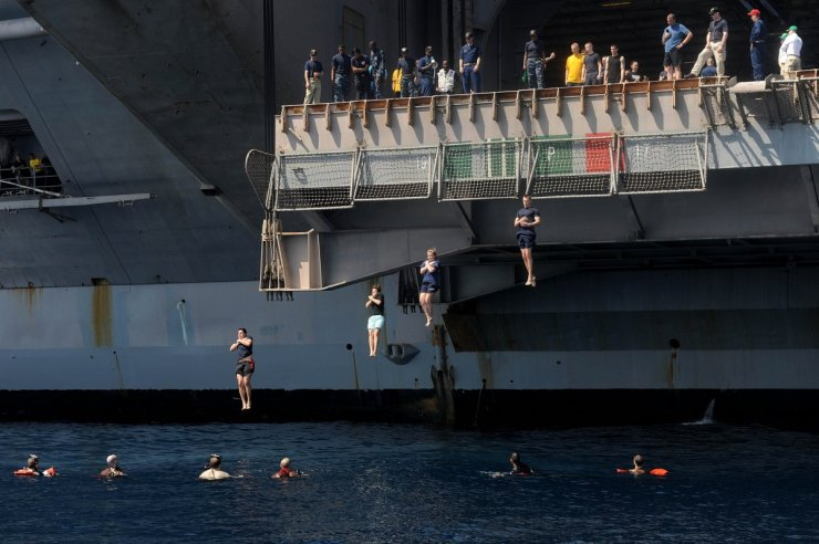 sailors-jump-from-the-uss-dwight-d-eisenhower-into-the-north-arabian-sea