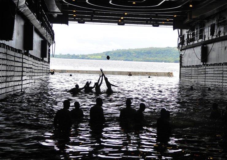 sailors-play-football-in-the-well-deck-of-the-uss-cleveland-off-of-the-coast-of-espiritu-santo-vanuatu