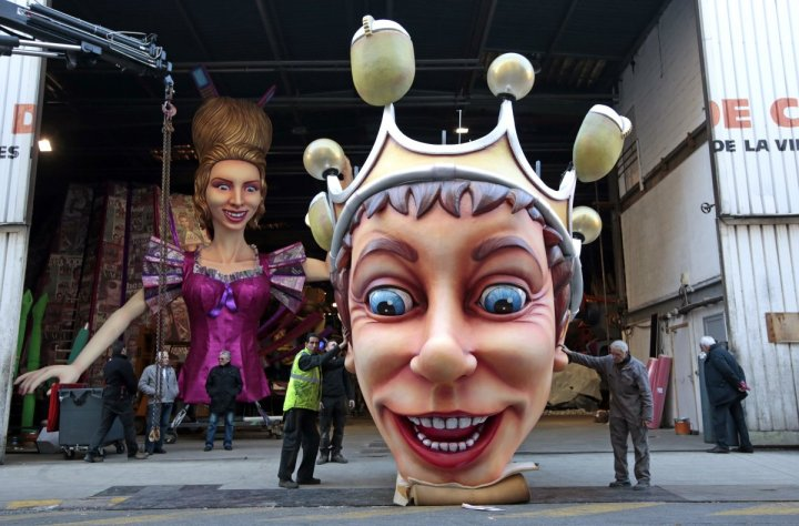 workers-hold-a-giant-figure-showing-the-king-of-carnival-during-preparations-for-the-carnival-parade-in-nice-france-on-february-11-2016