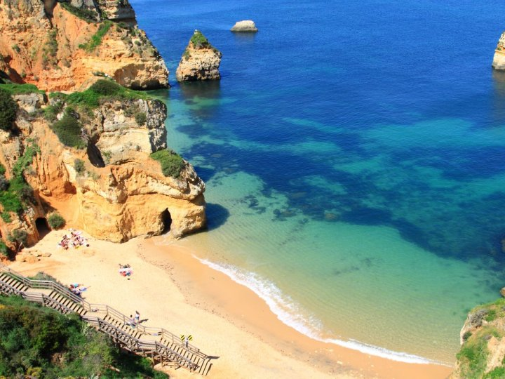 lagos-portugal--unwind-in-the-beautiful-coastal-city-of-lagos-while-taking-in-the-exciting-portuguese-culture-head-to-the-beach-and-see-the-ponta-da-piedade-a-series-of-uniquely-shaped-weathered-cliffs-in-t